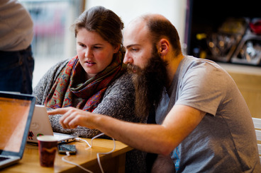 Guy and a girl looking at a laptop